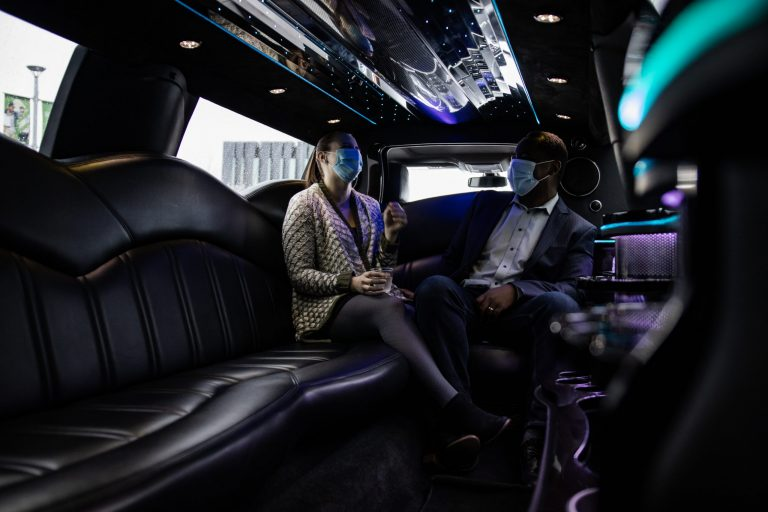 Anniversary Couple Sitting Inside of Lincoln MKT Limo for Avant Garde Limousines
