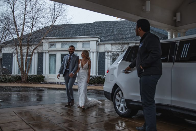 Avant Garde Limousines Wedding Client Outside Pickup in Lincoln MKT Limo