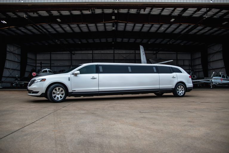 Drivers Side of Lincoln MKT Limo at Hanger for Avant Garde Limousines