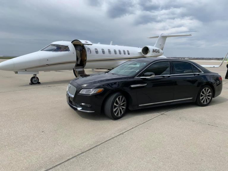Exterior Front of Lincoln Continental with Business Jet Avant Garde Limousines